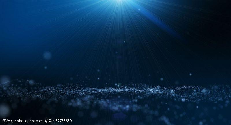 发光深蓝色辉光尘埃粒子抽象背景