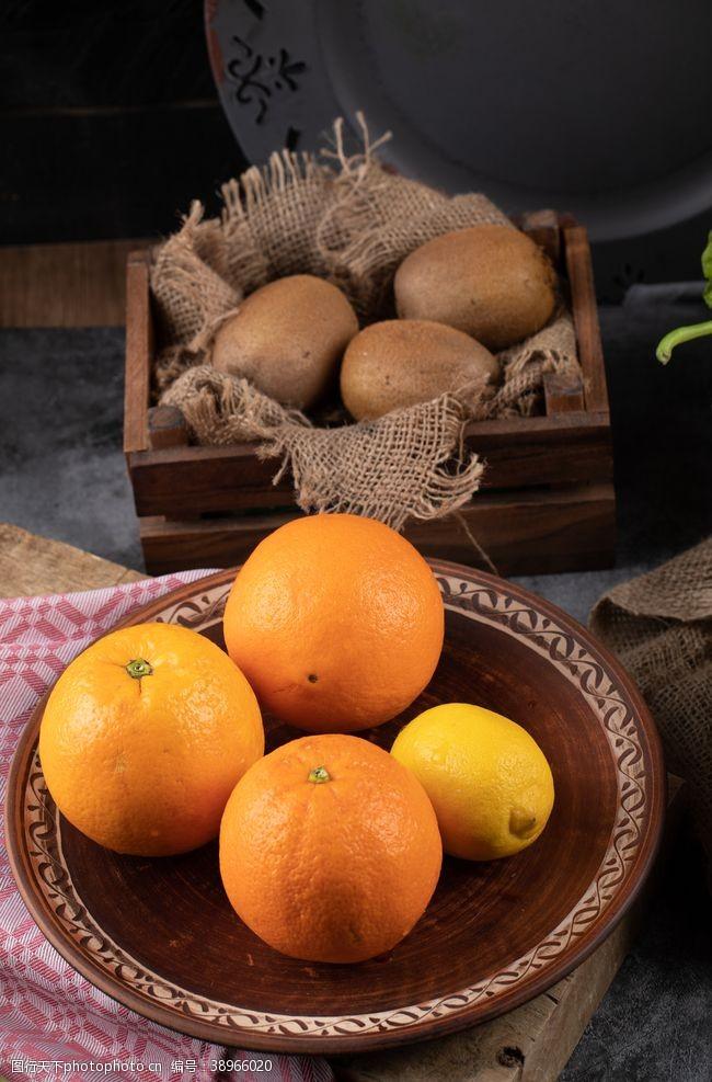 橙子猕猴桃新鲜水果背景素材图片